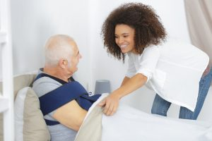 caring for a sick senior man in at home