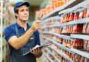 good looking hardware store worker counting stock